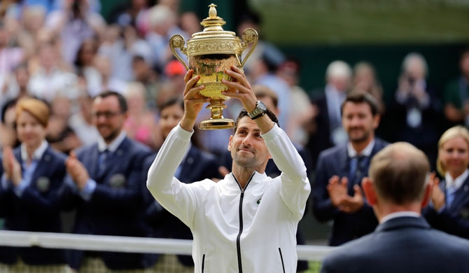 Djokovic beats Federer in longest Wimbledon singles final