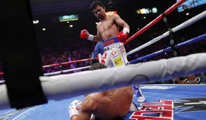 Pacquiao wins world title at 40