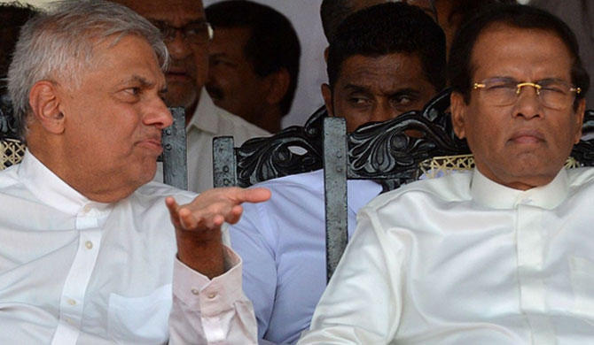 Sri Lanka's former President Maithripala Sirisena (R) and former Prime Minister Ranil Wickremesinghe (L) attending a commemoration ceremony to mark the 26th anniversary of the assassination of Sri Lanka's then-president Ranasinghe Premadasa in Colombo on May 1, 2019.  (Photo by : ISHARA S. KODIKARA/AFP via Getty Images)