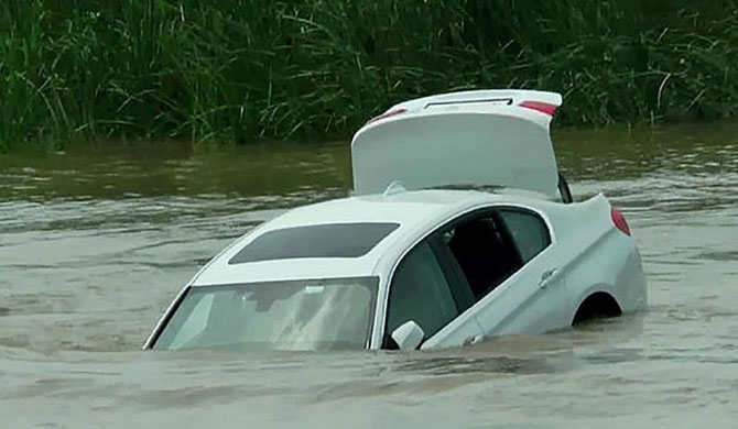 Man pushes birthday BMW into river (Video)