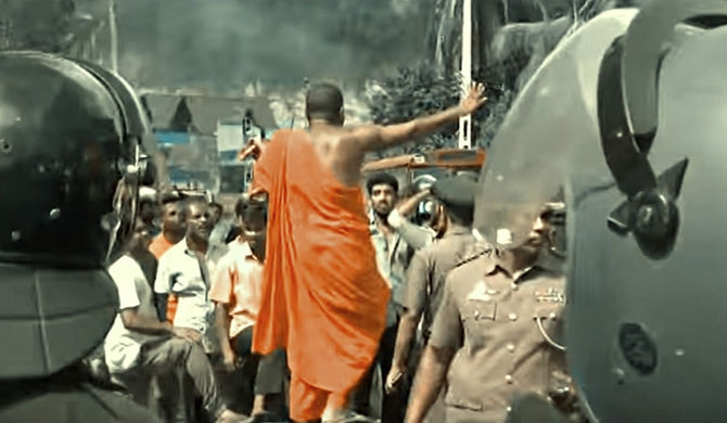 A Buddhist monk provoking anti-Muslim attacks  at Digana on March 05 (picture: jdslanka.org)