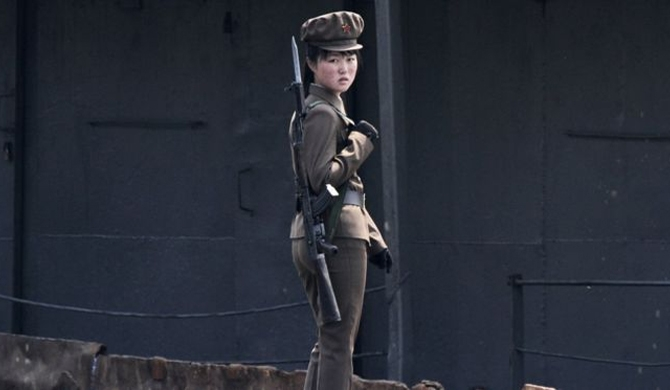 A North Korean soldier on the bank of the Yalu River (2014)