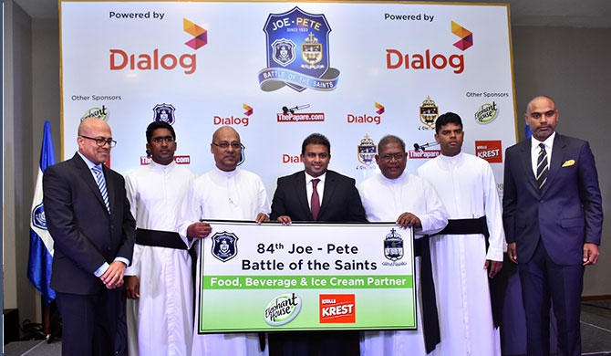 Sponsorship being handed over by Shanil Perera (centre), Head of Sales and Distribution – Keells Food Products PLC, Assistant Vice President - John Keells Holdings (JKH). Also in the picture is Rev. Fr Travis Gabriel (centre left), the rector of St. Joseph's College, and Rev. Fr Trevor Martin (centre right), the rector of St. Peter's College, in addition to members of the schools sports staff and big match organizing committee.