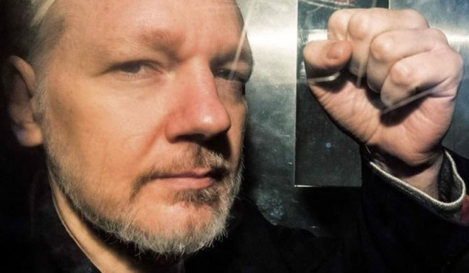 US lays new charges on Assange
