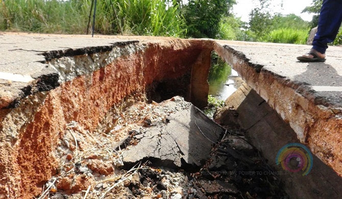 Road collapses obstructing travel (pics)