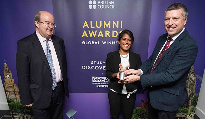 Global winner of the Professional Achievement category, Study UK Alumni Awards 2018, Asha de Vos (centre) receives her award from Sir Ciarán Devane, CEO, British Council (right).
