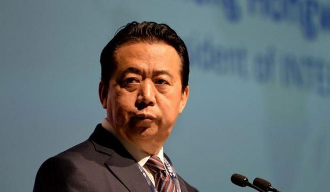 China holding missing Interpol head