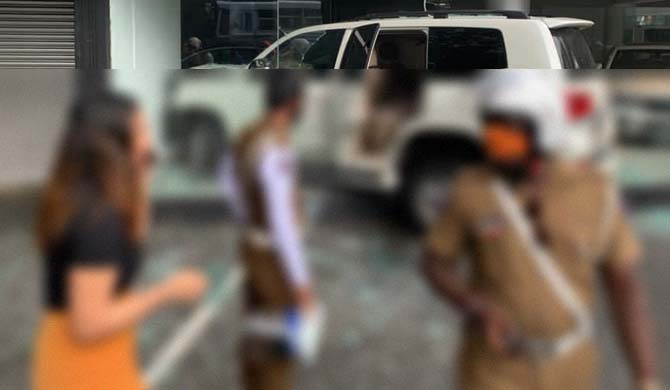 Who crashed a Land cruiser into a motor showroom?(Video)