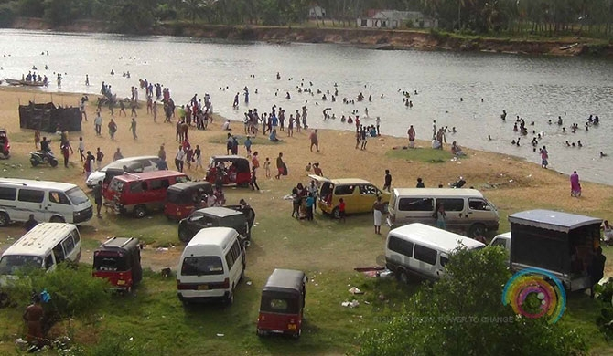Church devotees take a dip in Deduru Oya (Pics)